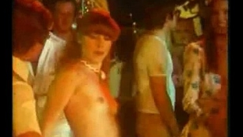 Girl jacks off gay blade in disco and gets fucked in retro porn movie