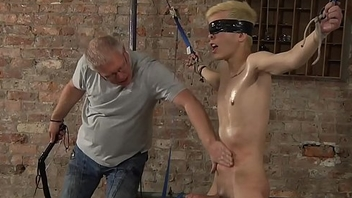 BDSM Alexis Tivoli slurps blond accompanying lad tied up whipped